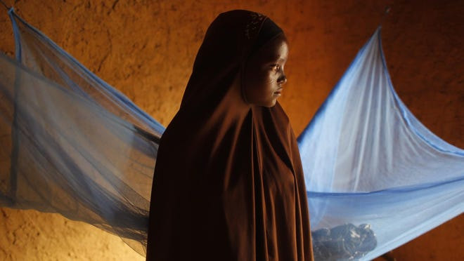 In this picture taken July 18, 2012,  Zali Idy, 12, poses in her bedroom in the remote village of Hawkantaki, Niger. Zali was married in 2011.