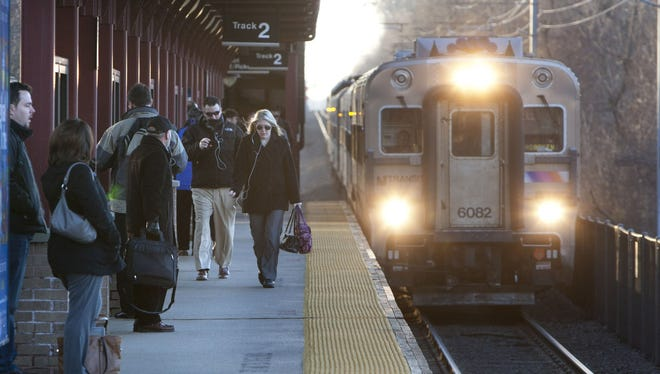 Early morning commuters prepare to board the northbound train at the Middletown, Del., station on March 4.