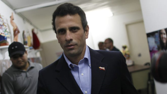 Opposition leader Henrique Capriles arrives for a press conference in Caracas, Venezuela, Friday.