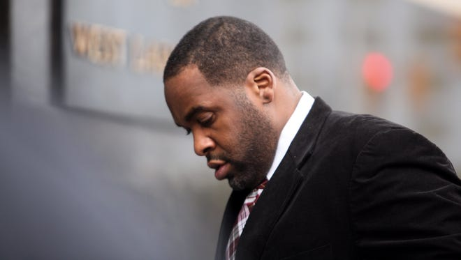 Former Detroit mayor Kwame Kilpatrick makes his way to federal court in Detroit on March 11. He was found guilty on multiple counts of extortion and several charges of mail fraud, wire fraud and filing of false taxes.