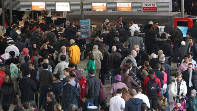 Passengers gather at the Frankfurt an Main airport's main hall earlier this year.
