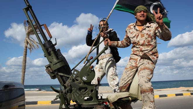 In this Tuesday Feb. 14, 2012 file photo, Libyan militias from towns throughout the country's west parade through Tripoli, Libya.