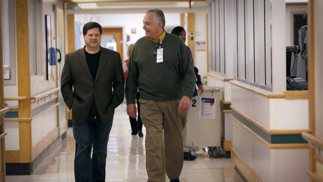 Dr. John Pestian, left, and Dr. Michael Sorter, photographed at Cincinnati Children's Hospital Medical Center on Feb. 25 are working to use science as a way to prevent suicide.