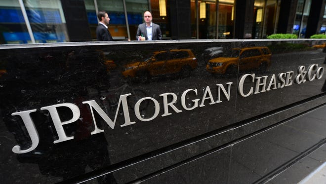 Two men speak outside JP Morgan Chase , Co. headquarters in New York on May 14, 2012.