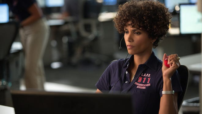 Halle Berry offers a convincing performance but can't escape the preposterous plot holes in 'The Call.'