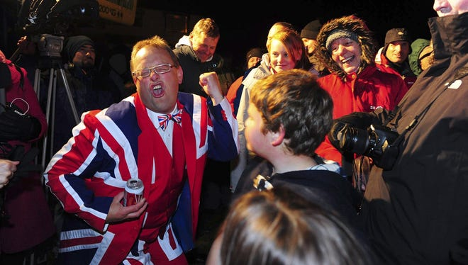 Residents celebrate the results of a referendum in  Stanley, Falkland Islands, on March 11.