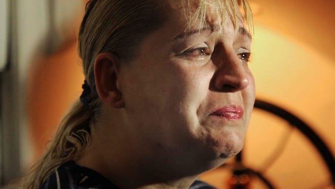 Sherry West  breaks down in tears as she describes the incident the day before where her 13-month-old son was fatally shot and she was wounded Friday.