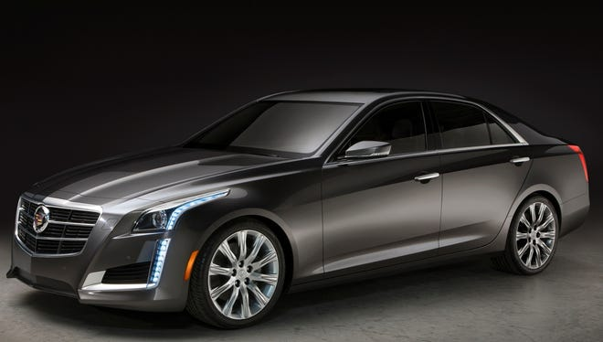 Cadillac has  stretched, lowered and lightened  the 2014 CTS midsize sedan, which goes on sale in the fall. A high-performance version has more than 400 hp.