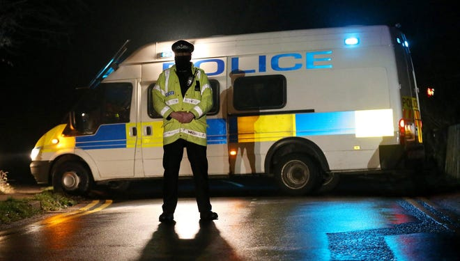 Police stand guard Saturday at a roadblock where it is believed Boris Berezovsky lived near Sunningdale, England.