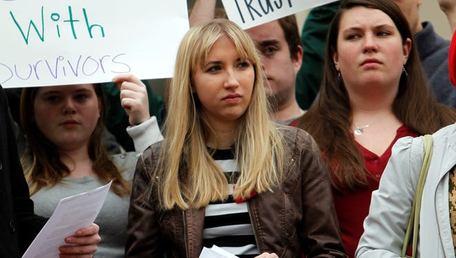 UNC-Chapel Hill sophomore Landen Gambill, center, stands with supporters during a rally onMarch 1, 2013, on the steps of the South Building on campus.