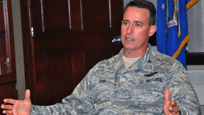 Col. Tim Bush, pictured here in a 2011 photo, was relieved of his command after failing the waist measurement of his physical fitness test. He was 2 inches over the 39-inch limit set as an Air Force standard.