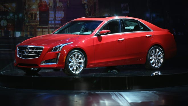 The 2014 Cadillac CTS sits on display during the unveiling event Tuesday in New York City ahead of the New York Auto Show.