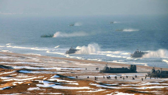 "This picture released by North Korea's official Korean Central News Agency shows a military exercise by North Korean forces on March 25.  AFP/Getty Images later withdrew the photo ""due to excessive digital alternation, compromising its news content."""