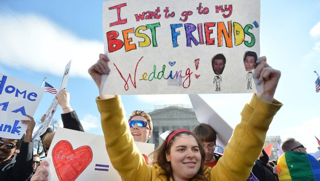 Same-sex marriage supporters demonstrate in front of the Supreme Court on March 27, 2013 in Washington, D.C.