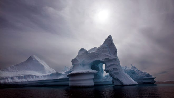 In this July 19, 2007 file photo an iceberg is seen off Ammassalik Island in Eastern Greenland.