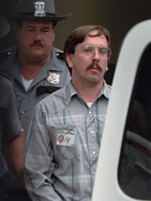 Admitted serial killer Joel Rifkin is escorted from court in Mineola, N.Y., in this July 1993, file photo.