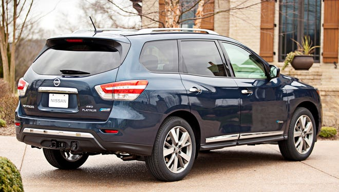 NIssan adds a gas-electric hybrid model to the redesigned Pathfinder lineup. The 2014 hybrid boosts mileage rating 5 mpg. It goes on sale this summer, priced $3,000 more than similar gasoline version, Nissan said at the New York auto show.