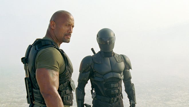 Dwayne Johnson, left, joins the cast as Roadblock, while Ray Park reprises his role as Snake Eyes in 'G.I. Joe: Retaliation.'