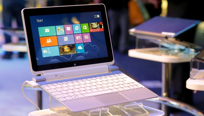 An Acer Iconia W510 tablet running on Windows 8 is on display at the Intel booth at the International Consumer Electronics Show in Las Vegas, Wednesday, Jan. 9, 2013.