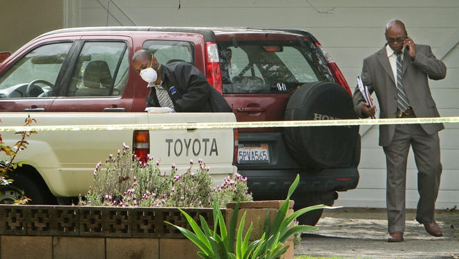 A vehicle is dusted for prints in the driveway of a home on the 8800 block of Oakdale Avenue near Nordhoff Street Wednesday, in Northridge, Calif., where a 10-year-old girl disappeared during the night.