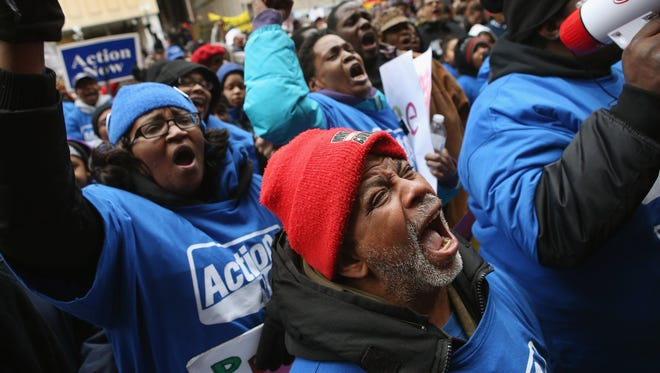 Demonstrators protest school closings on Wednesday in Chicago.