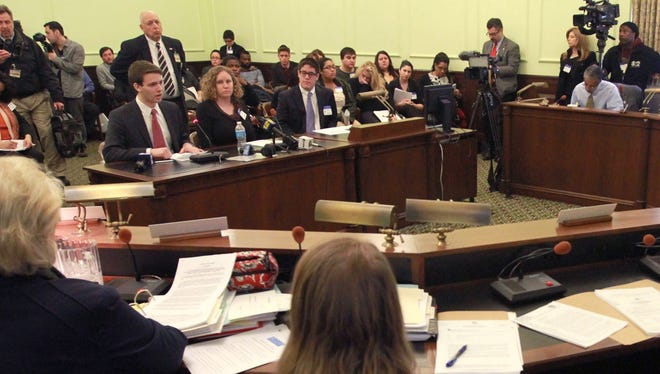 Jacob Rudolph, left, a Parsippany Hills High School senior who became a YouTube sensation after he delivered a speech to classmates in which he announced he was gay, testifies before the New Jersey Senate Health Committee in Trenton on March 18.