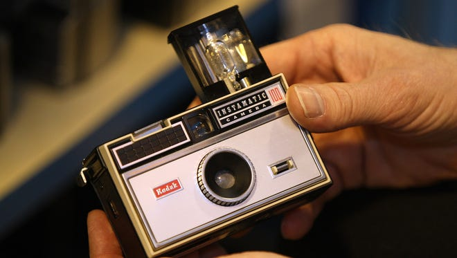 Todd Gustavson, curator of technology at the George Eastman House International Museum of Photography and Film in Rochester, N.Y., displays a Kodak Instamatic 100 camera