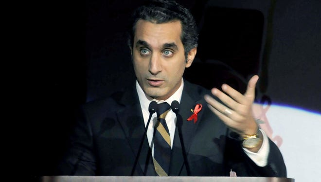 In this Saturday Dec. 8, 2012 file photo, Egyptian TV host Bassem Youssef addresses attendants at a gala dinner party in Cairo.