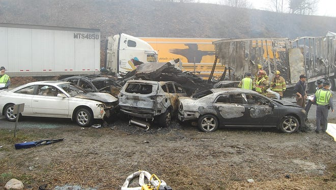 This photo provided by the Virginia State Police shows the scene following a 95-vehicle pileup on Interstate 77 near the Virginia-North Carolina border in Galax, Va., on Sunday. (AP Photo/Virginia State Police, Sgt. Mike Conroy)