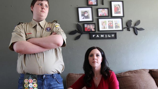 Sandy Rakowski, photographed with her son on March 27 at their Wilmington, Del. home, loves the Boy Scouts for the values they teach 14-year-old James but is outraged and increasingly embarrassed by the Scouts' controversial policy barring gay members and leaders.