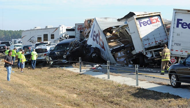 Cars and trucks are piled on Interstate 10 after an accident near Beaumont, Texas, on Nov. 22, 2012.