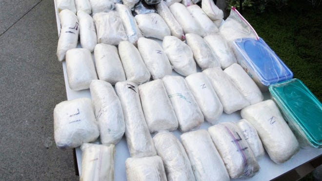 Weapons and drugs were seized by the Drug Enforcement Administration from the Mexican La Familia drug cartel, which operates in California.