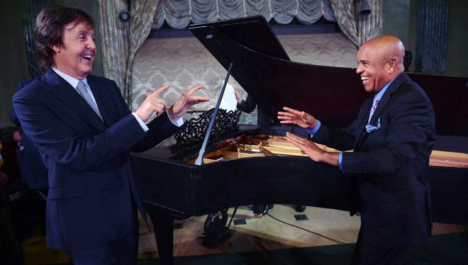 In this Sept. 18, 2012 file photo provided by the Motown Museum, Paul McCartney, left, and Berry Gordy stand in front of a newly restored 1877 Steinway grand piano during a benefit at the Motown Museum at Steinway Hall in New York.