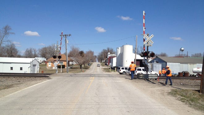 A northbound view of the Batavia, Iowa site on April 2 where a train collided with a minivan, killing two Iowa children the day before. Tara Lewman allegedly drove around a lowered railroad crossing gate in her 2004 Dodge Caravan when her vehicle was struck by a westbound train.