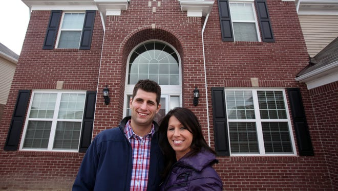 First-time buyers Bryan Carter, 28, and Lisa Valesano, 30, skipped over traditional starter homes like bungalows to get the house they wanted from the start. They built this 3,100-square-foot home in Macomb, Mich., priced in the $300,000s.