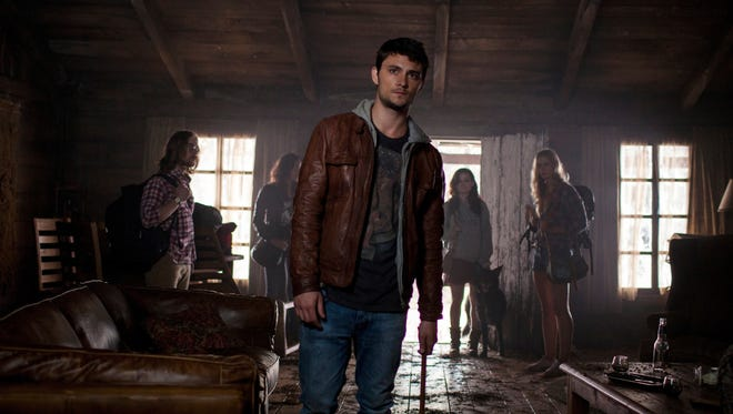 Lou Taylor Pucci, left, Jessica Lucas, Shiloh Fernandez, Jane Levy and Elizabeth Blackmore star in the remake of 'Evil Dead,' which offers grizzly pandemonium and graphic gore, but loses the humor of the original.
