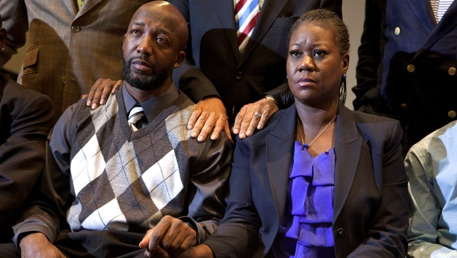 The parents of Trayvon Martin, Tracy Martin and Sybrina Fulton, right, attend a news conference on April 11, 2012, in Washington