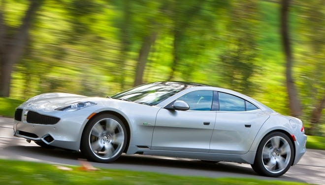 Fisker Karma plug-in hybrid has been out of production since last year. The company laid off most workers, and now is being sued because it gave them no notice.