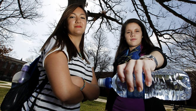 Drake students Amy Duong, left, and Leslie Sabick, photographed on April, 8, 2013 at the Des Moines, Iowa campus, are leading an effort to ban the sale of bottled water on campus.