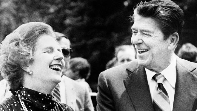 Britain's Prime Minister Margaret Thatcher and President Ronald Reagan share a laugh during a break from a session at the Ottawa Summit on July 21, 1981, at Government House in Ottawa, Canada.