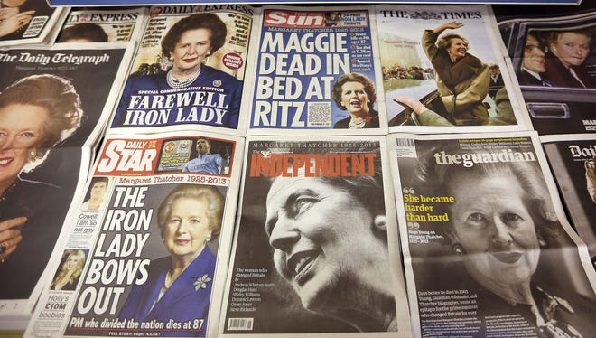 Newspapers at a news agent shop cover the death of former prime minister Lady Thatcher on April 9.