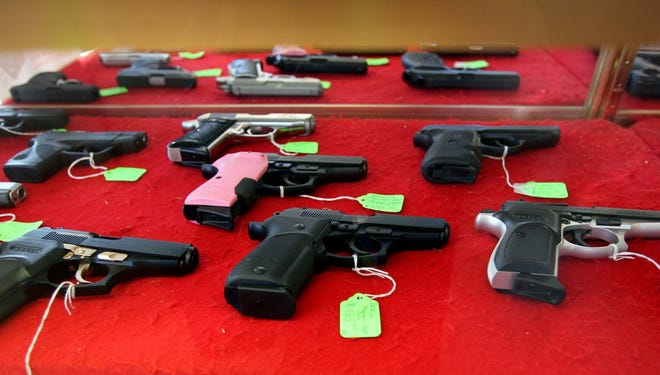 Hand guns are seen for sale at a gun store in  Roseville, MIch.