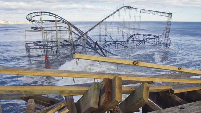Casino Pier's Jet Star roller coaster, a symbol of Superstorm Sandy's devastation, remains at sea on Jan. 31, washed over daily by waves in the Atlantic. Much of the pier and surrounding boardwalk were destroyed in the wake of Sandy in October.