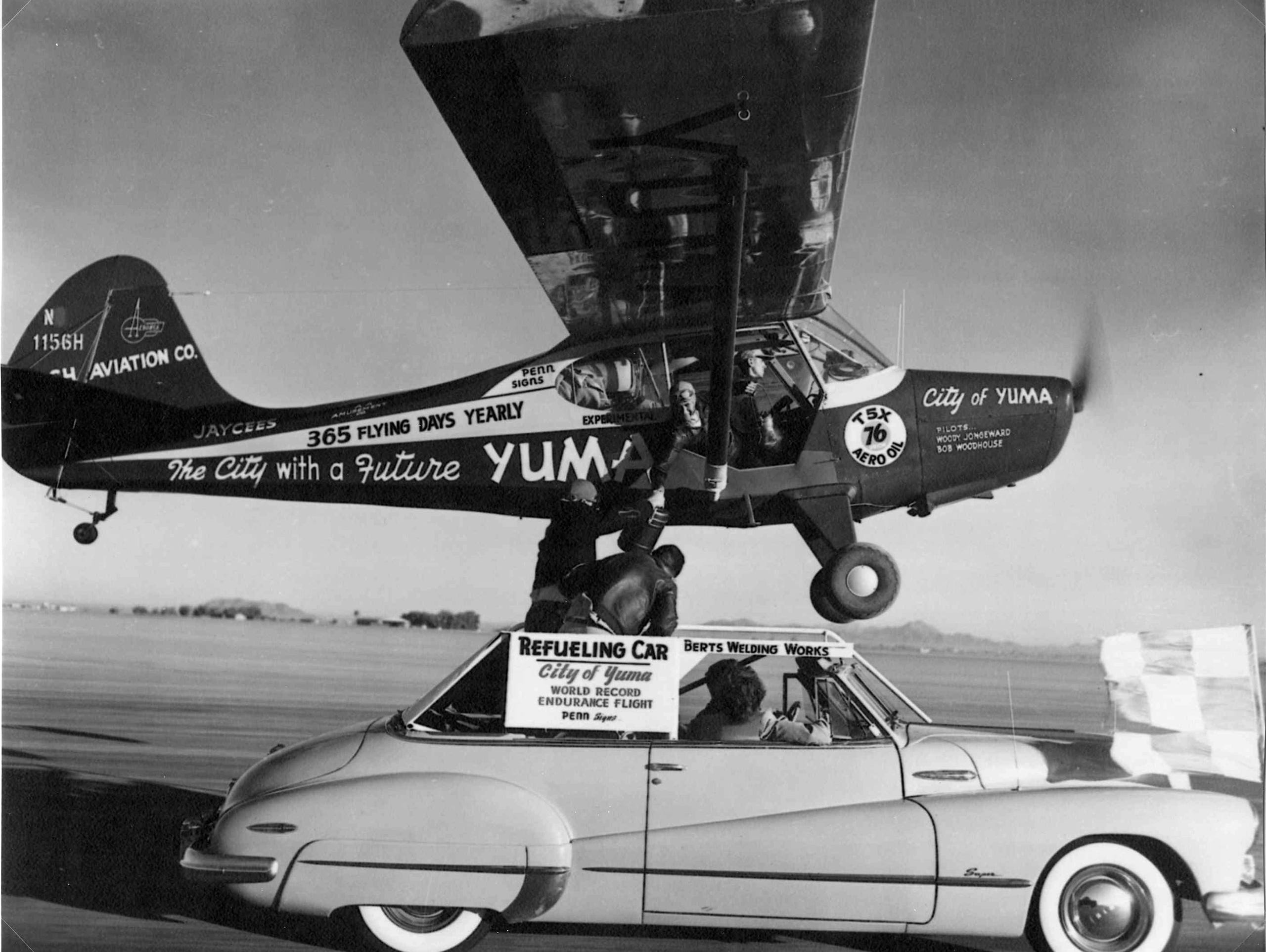 Bob Hodge, in the speeding Buick,  hands breakfast and lunch to Bob Woodhouse in an Aeronca Sedan flying low over a Yuma, Ariz. airstrip in 1949.