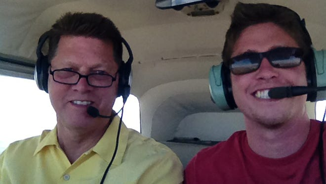 Matt Pipkin, right, with his father, Chet, want to keep a small aircraft aloft long enough to break the flight endurance record of nearly 65 days.