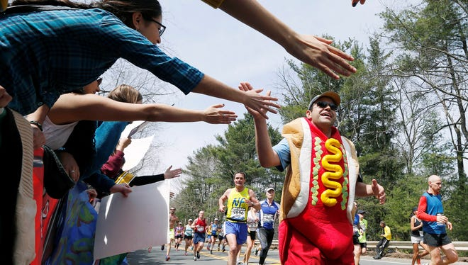 A man dressed as a hot dog competes during the 117th running of the Boston Marathon in Wellesley, Mass. For runners and spectators, the marathon is a Patriots' Day ritual.
