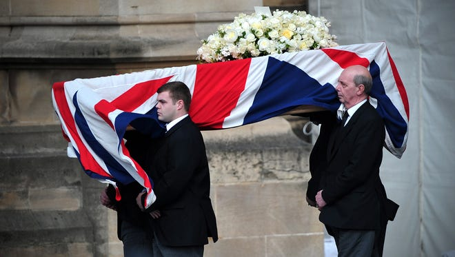 Pallbearers carry the coffin of former British prime minister Margaret Thatcher.
