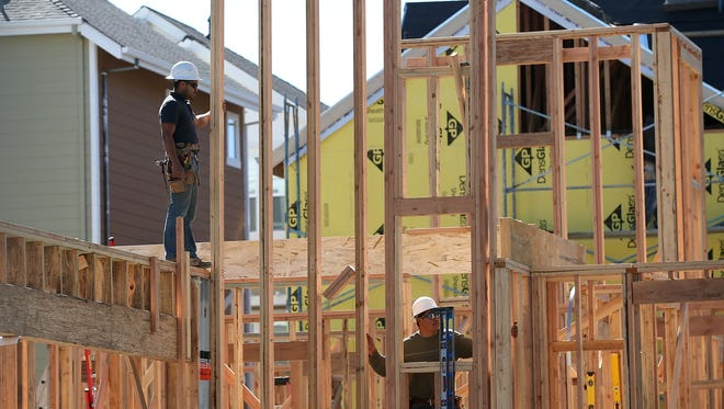 SAN MATEO, CA - APRIL 16:  Workers build walls of a new home at a housing development on April 16, 2013 in San Mateo, California.  The Commerce Department reported that new home construction was up 7 percent in March from February, the biggest gain since June 2008. A surge of apartment construction led the monthly gain.  (Photo by Justin Sullivan/Getty Images) ORG XMIT: 166911614 ORIG FILE ID: 166751411