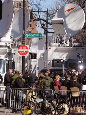 Members of the media camp out at the corner of Boylston St., near the site of the Boston Marathon attacks. On Wednesday, several media outlets reported that a suspect had been arrested in the case, only to have to retract the story later.
