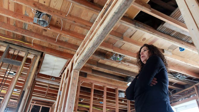 After her insurance company told her the damage to the roof of her Lavallette, N.J. cottage left by superstorm Sandy was minor, Diana Rocco, photographed in the gutted cottage on March 29, 2009, became one of a growing number of homeowners seeking legal assistance with claims related to Sandy.